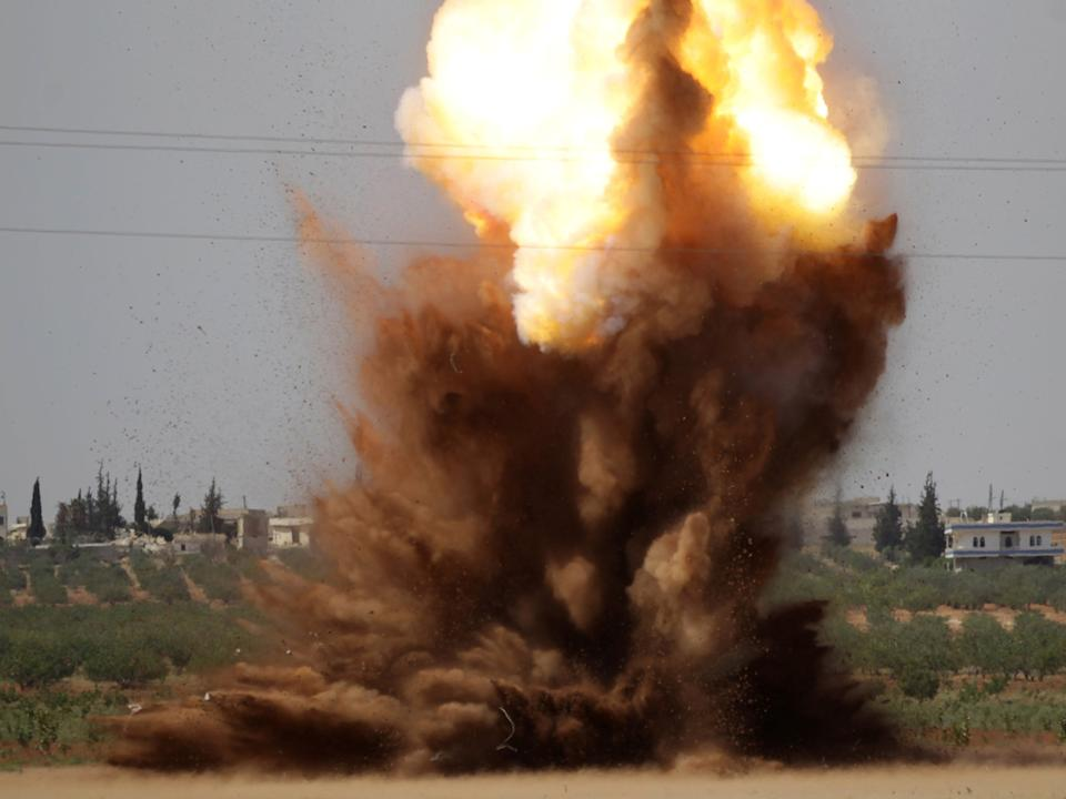 Smoke rises after civil defence members safely detonate cluster bombs inside a field in al-Tmanah town in southern Idlib countryside, Syria: Reuters
