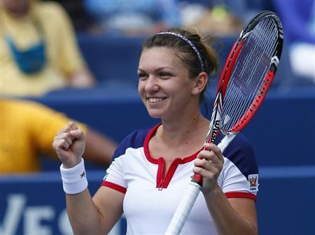 Simona Halep of Romania reacts after defeating Maria Kirilenko of Russia at the U.S. Open tennis championships in New York August 31, 2013. REUTERS/Kena Betancur
