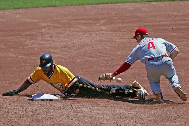 Philadelphia Phillies' Scott Kingery (4) has the ball pop out of his glove as Pittsburgh Pirates' Starling Marte, left, steals second base in the third inning of a baseball game in Pittsburgh, Sunday, July 8, 2018. (AP Photo/Gene J. Puskar)