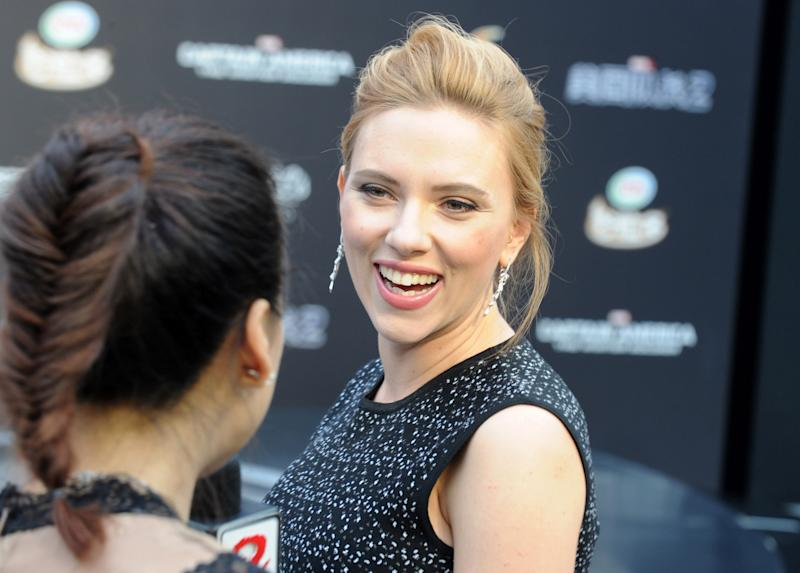 US actress Scarlett Johansson arrives to attend a press conference at a shopping mall in Beijing on March 24, 2014 (AFP Photo/Mandy Wang)