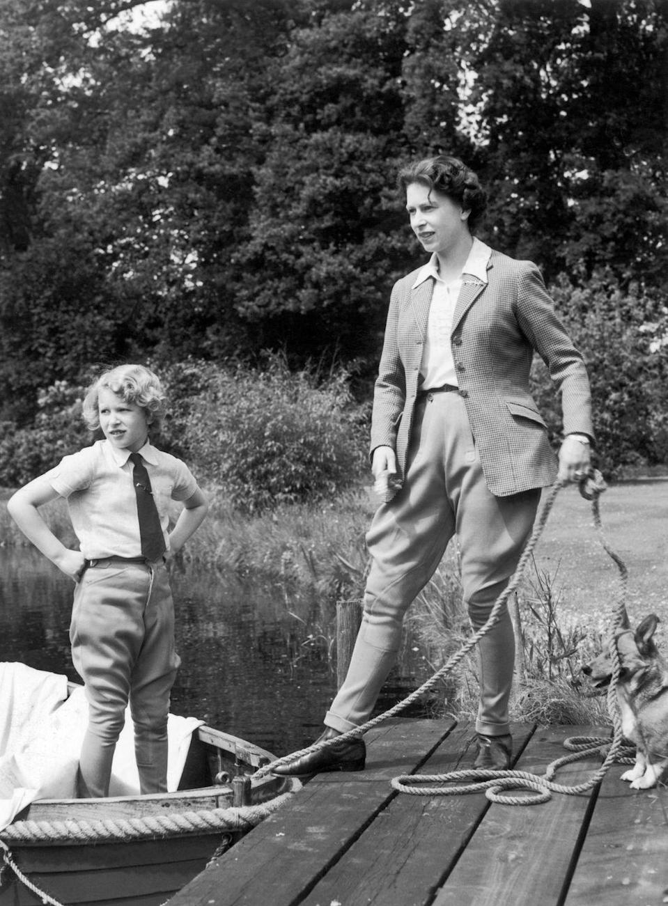"""<p>The 1950's saw a rise of women wearing pants while pregnant — usually paired with a smock top. While we never saw Queen Elizabeth adopt the style that was popularized by <a href=""""https://www.elle.com/fashion/personal-style/g28423/maternity-style-evolution/?slide=42"""" rel=""""nofollow noopener"""" target=""""_blank"""" data-ylk=""""slk:Lucille Ball"""" class=""""link rapid-noclick-resp"""">Lucille Ball</a> on <em>I Love Lucy</em>, this ensemble of high waisted britches, button down shirt and blazer was the closest Her Majesty came to the maternity trend.  </p>"""