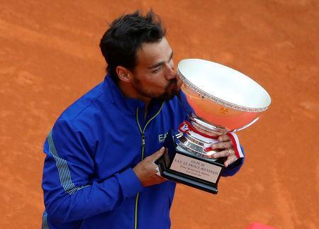 Tennis - ATP 1000 - Monte Carlo Masters - Monte-Carlo Country Club, Roquebrune-Cap-Martin, France - April 21, 2019 Italy's Fabio Fognini celebrates with the trophy after winning the Monte Carlo Masters REUTERS/Jean-Paul Pelissier