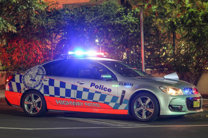 NSW Police have fined a man for having three unrestrained children in his car. Pictured is a stock image of a highway patrol car.