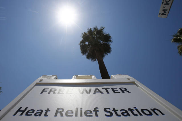 <p>A Salvation Army hydration station sign gets hit by the midday sun as temperatures climb to near-record highs, June 19, 2017, in Phoenix. (Ross D. Franklin/AP) </p>
