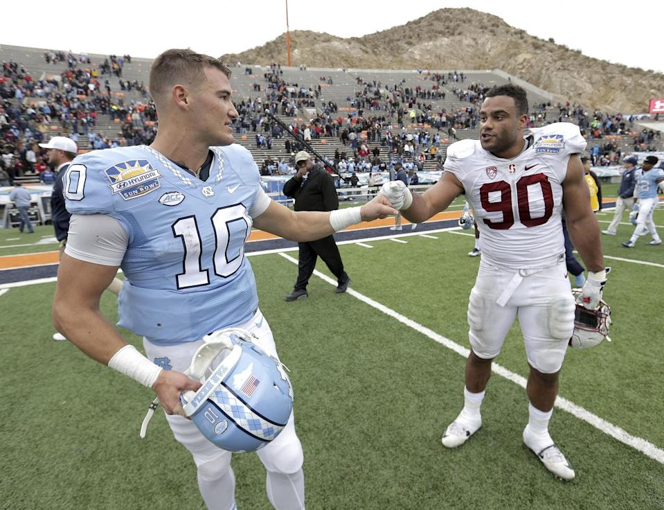 North Carolina QB Mitchell Trubisky, left, and Stanford DL Solomon Thomas could both end up top-10 picks. (AP)