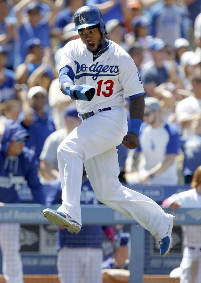 Los Angeles Dodgers' Hanley Ramirez (13) reacts running to score at home without a throw on a single to center by the Dodgers' Adrian Gonzalez in the sixth inning of a baseball game against the San Francisco Giants on Sunday, May 11, 2014, in Los Angeles. (AP Photo/Alex Gallardo)