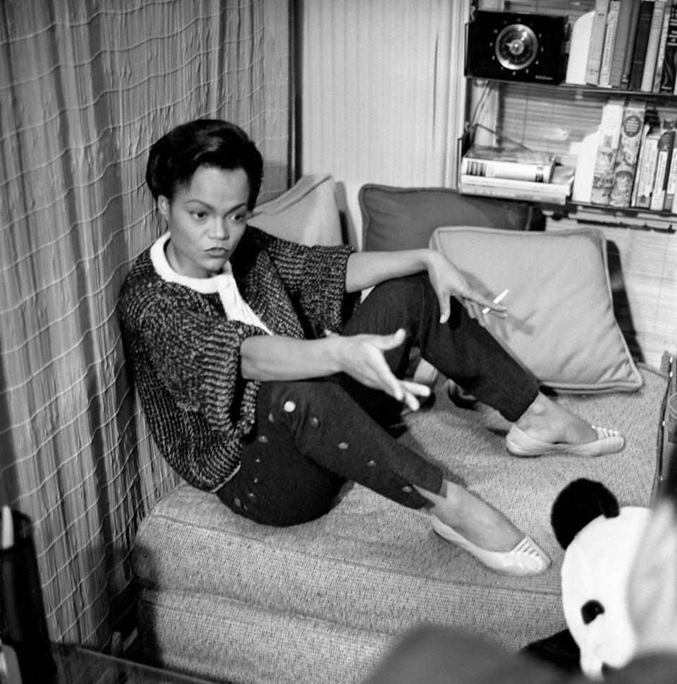 <p>Kitt, in her home in New York, is interviewed for the television show <em>Person to Person </em>wearing a button-up sweater and cropped pants, also decorated with brass buttons. </p>