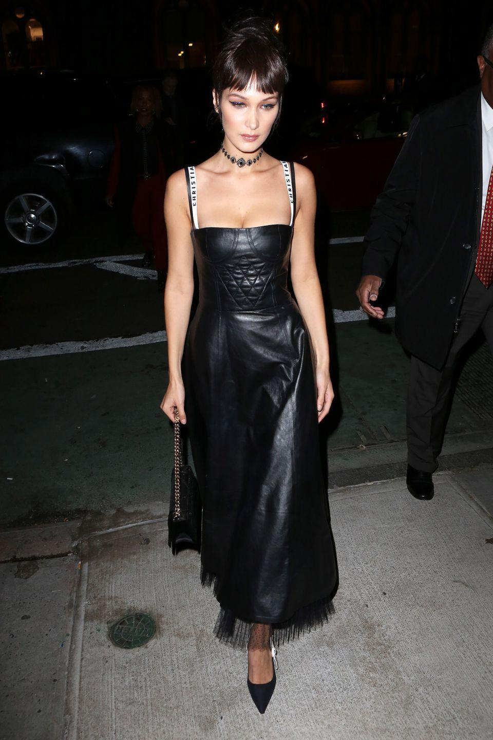 """<p>In a leather Dior Spring 2017 dress with a quilted bustier, """"Christian Dior"""" straps and tulle hemline, pointed-toe pumps, chain strap handbag and jeweled choker while out in New York. </p>"""
