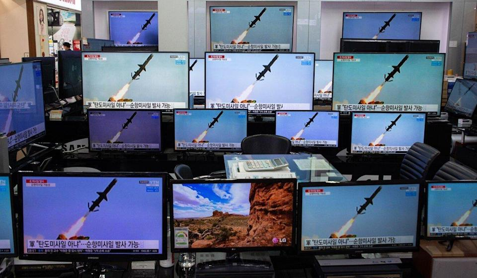 TV screens at the Yongsan electronics market in Seoul, South Korea, show footage of the North Korean rocket launches on Wednesday. Photo: EPA-EFE