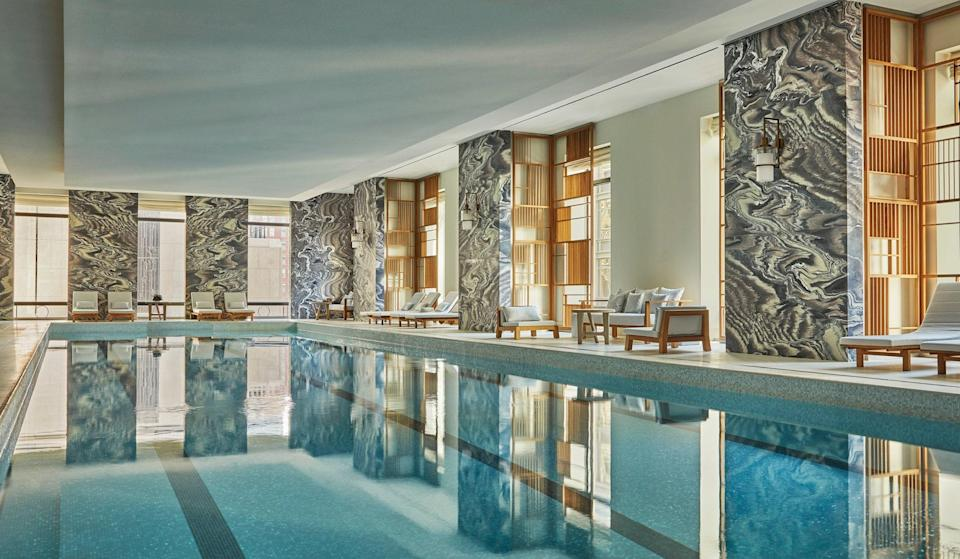 """<p><strong>Why book?</strong> Find the luxuries of uptown presented in a more contemporary style at this second NYC Four Seasons. It's also home to one of the city's best hotel spas.</p> <p><strong>Set the scene:</strong> Set in Lower Manhattan, down the block from the landmark Woolworth Building, this 82-story tower features interiors by noted design firm Yabu Pushelberg, who have infused it with a comfortable, contemporary feel. The building also houses 157 private apartments, and that hushed residential atmosphere can be felt on the 24 hotel floors, as well, resulting in luxury that is more polished and sedate than gilded or ornate. The place draws the guests you might expect—well-heeled families, business travelers, Four Seasons loyalists—as well as area residents who are members of the fitness club or regulars at the CUT restaurant and bar.</p> <p><strong>The backstory</strong>: While the striking, I.M. Pei-designed midtown Four Seasons is a city icon, there was plenty of anticipation for the opening of this """"little sister"""" back in 2016—when the fact that a Four Seasons was coming to the Financial District was seen as proof of the area's evolution. It's delivered on that promise ever since, offering the only true five-star experience this far south on the island.</p> <p><strong>The rooms</strong>: All 161 rooms and 28 suites are cushy but uncluttered, with an airy décor made up of contemporary furnishings, tall windows and the famously fluffy Four Seasons beds (with bedding that can be customized to your preferences). All offer sweeping city views—it's just the direction that differs—and all come with discreet mini-bars stocked with snacks, spirits, elegant barware and both a Nespresso coffee maker and Bodrum tea kettle. Tech includes Smart TVs and iPads with which to access hotel services, and the spacious bathrooms—most clad in marble—have in-mirror TVs, as well as separate showers and soaking tubs; save some room in your suitcase for the beautifully scented """