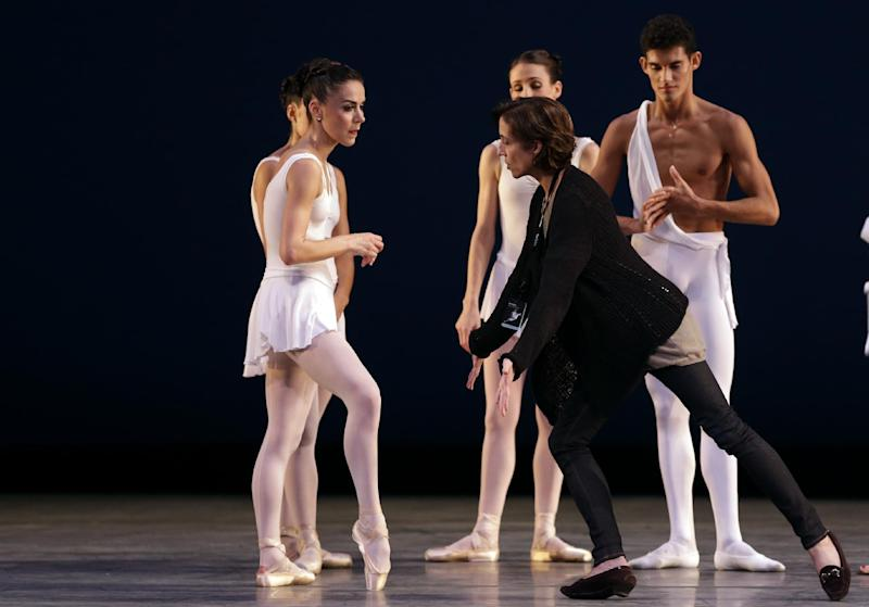 In this Thursday, Oct. 18, 2012 photo, Lourdes Lopez, the new artistic director for the Miami City Ballet, center, demonstrates a dance move to dancers during a dress rehearsal for the ballet's performance of Apollo, in Miami. Lopez left Miami 40 years ago to pursue a career in dance. She returns to a city with a vibrant arts scene. (AP Photo/Lynne Sladky)
