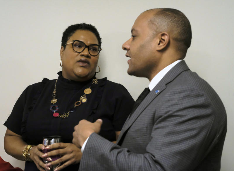 Del. Marcia Price, D-Newport News, left, and Garrett Arwa, Director of Capaigns for the National Democratic Redistricting Committee, right, confer before a press conference dealing with Price's HB1256, a redestricting bill, inside the Pocahontas Building in Richmond, Va., Tuesday, Jan. 14, 2020. (Bob Brown/Richmond Times-Dispatch via AP)