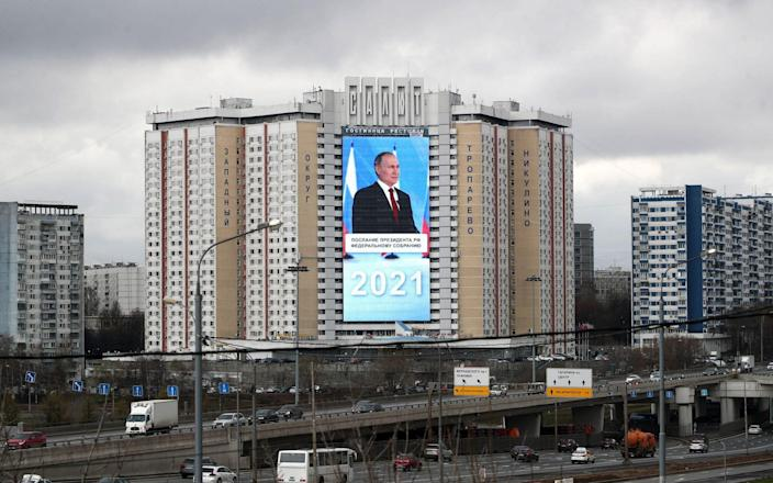 A live broadcast of Russian President Vladimir Putin's annual address to the Federal Assembly of the Russian Federation on the facade of the Salyut Hotel - TASS News Agency/Alamy Live News