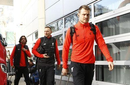 Liverpool's Simon Mignolet arrives at the ground before the match