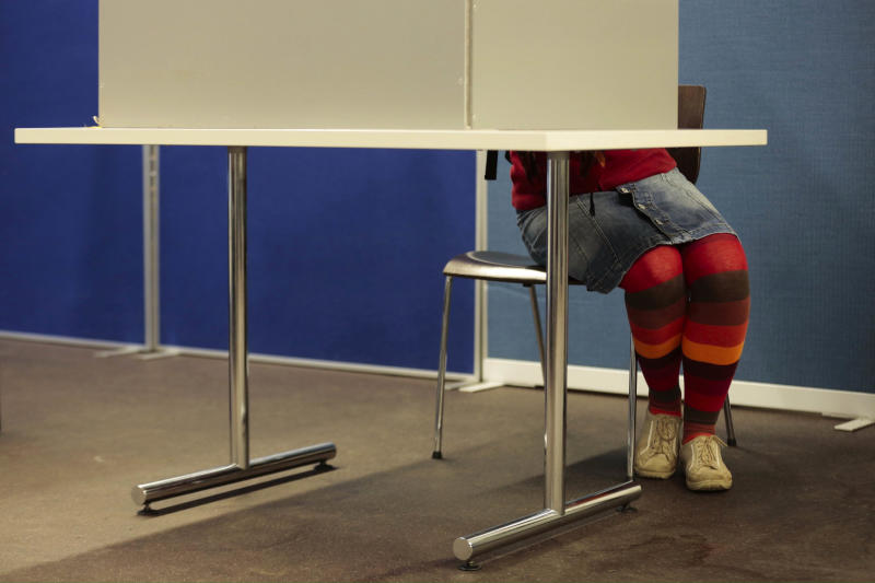 A voter casts her ballot at a polling station in Berlin, Sunday, Sept. 22, 2013. Nearly 62 million people were eligible to elect the lower house of Parliament, which in turn chooses the chancellor (AP Photo/Markus Schreiber)