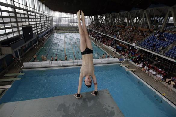 Crystal Palace diving club member Ford Fagan dives during a training session in London March 9, 2012.