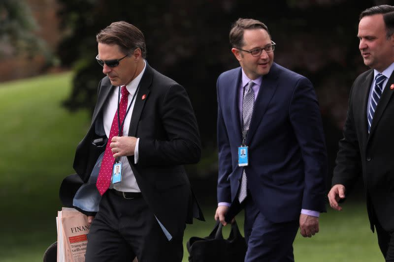 FILE PHOTO: White House aide Blair, Deputy Assistant to the President Hoelscher and White House Director of Social Media Scavino walk to Marine One helicopter for travel to Florida from White House in Washington