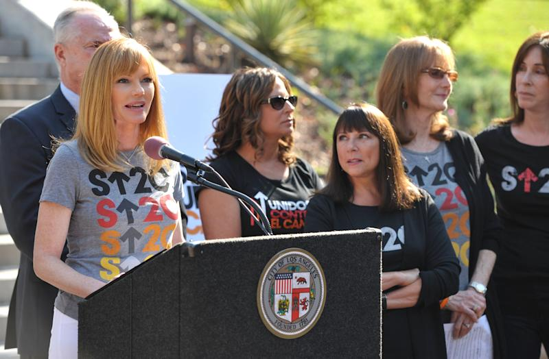 """Actress Marg Helgenberger, left, appears at the Stand Up To Cancer Day announcement at Los Angeles City Hall on Tuesday, Sept. 4, 2012. Councilmember Paul Koretz and the City of Los Angeles held the news conference to declare Friday, Sept. 7 as the official """"Stand Up To Cancer Day"""" in Los Angeles. (Photo by John Shearer/Invision/AP)"""