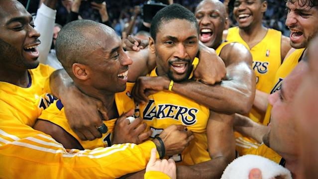 """Metta World Peace, known then as Ron Artest, is congratulated by Kobe Bryant and his Lakers teammates after making a game-winning shot against the Suns in the 2010 playoffs. <span class=""""copyright"""">(Wally Skalij / Los Angeles Times)</span>"""