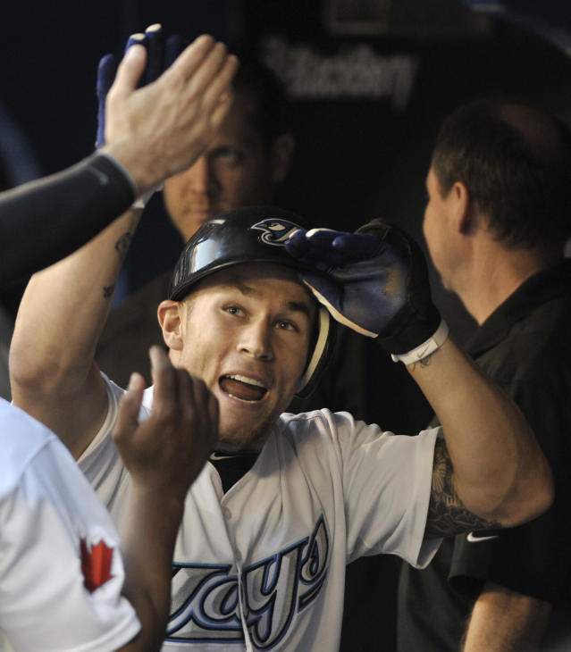 TORONTO, CANADA - AUGUST 26: Brett Lawrie #13 of the Toronto Blue Jays celebrates his home run with teammates during MLB game action against the Tampa Bay Rays August 26, 2011 at Rogers Centre in Toronto, Ontario, Canada. (Photo by Brad White/Getty Images)