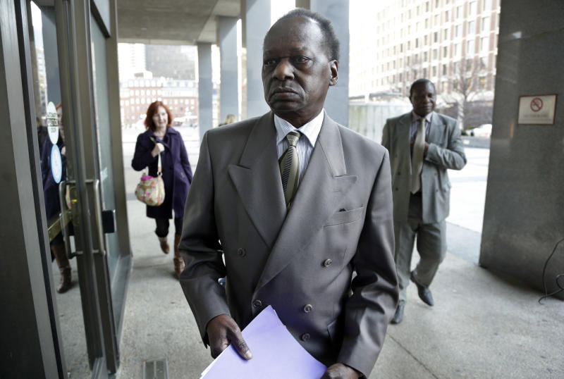 Onyango Obama, President Barack Obama's Kenyan-born uncle, arrives at U.S. Immigration Court for a deportation hearing Tuesday, Dec. 3, 2013 in Boston. He has lived in the United States since the 1960s, when he came here as a teenager to attend school. (AP Photo/Steven Senne)