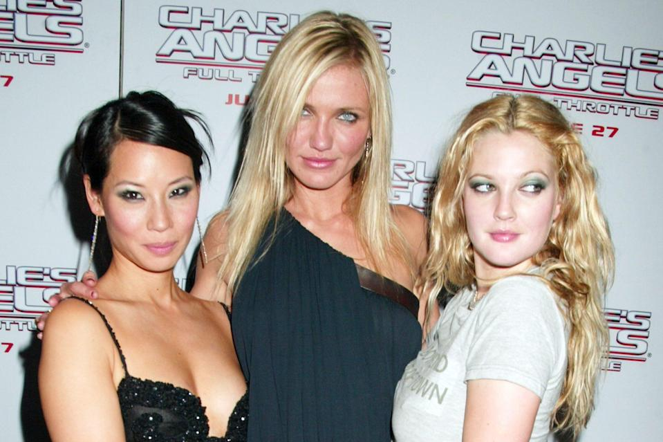 <p>Post-champagne sipping, the trio posed for a sultry shot together. </p>
