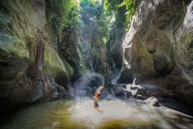 Hidden Canyon Beji Guwang with pools, waterfalls & carved rocks, is a Tranquil natural destination in a hard-to-find locale (Photo: Khaichuin Sim via Getty Images)