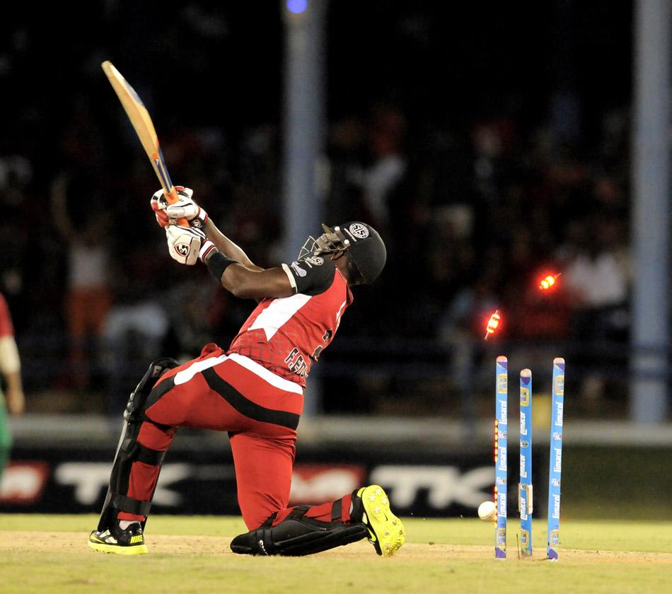 PORT OF SPAIN, TRINIDAD AND TOBAGO - AUGUST 22:  Fidel Edwards of Trinidad and Tobago Red Steel bowled by Guyana Amazon Warriors Lasith Malinga during the First Semi Final of the Caribbean Premier League between Guyana Amazon Warriors v Trinidad and Tobago Red Steel at Queens Park Oval on August 22, 2013 in Port of Spain, Trinidad and Tobago. (Photo by Randy Brooks/LatinContent/Getty Images)