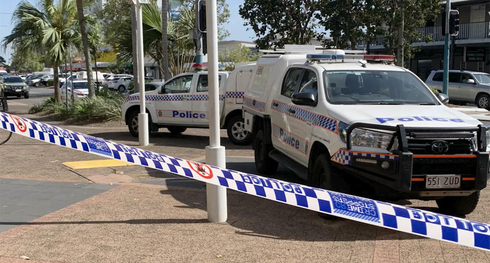 Two police cars sit outside Cairns Central Shopping Centre.