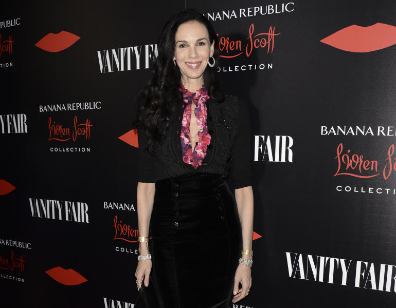 FILE - This Nov. 19, 2013 file photo shows fashion designer L'Wren Scott at the Banana Republic L'Wren Scott Collection launch party at the Chateau Marmont in West Hollywood, Calif. Scott, a fashion designer, was found dead Monday, March 17, 2014, in Manhattan of a possible suicide. (Photo by Dan Steinberg/Invision/AP, File)
