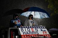 Supporters watch as Democratic presidential candidate Joe Biden speaks during a drive-in rally in Philadelphia, Pennsylvania, a state his campaign feels he must win if he is to defeat President Donald Trump on Tuesday
