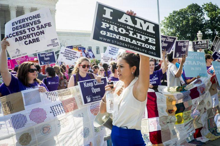 Pro-choice and pro-life activists demonstrate on the steps of the United States Supreme Court on June 27, 2016 in Washington, DC. (Photo: Pete Marovich/Getty Images)