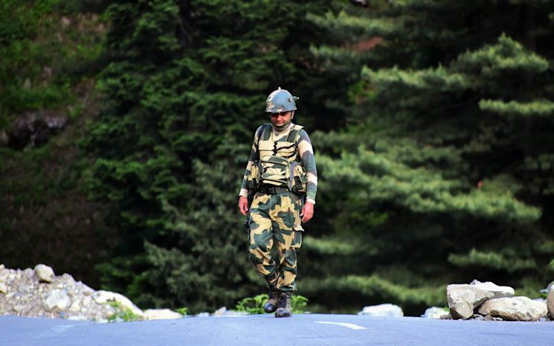 An Indian Border Security Force soldier walks near a check post along the Srinagar-Leh National highway on June 16, 2020