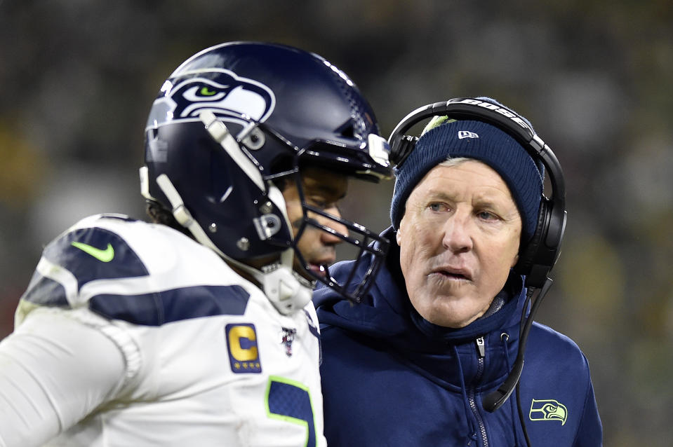Things are good between Russell Wilson and Pete Carroll. (Photo by Quinn Harris/Getty Images)