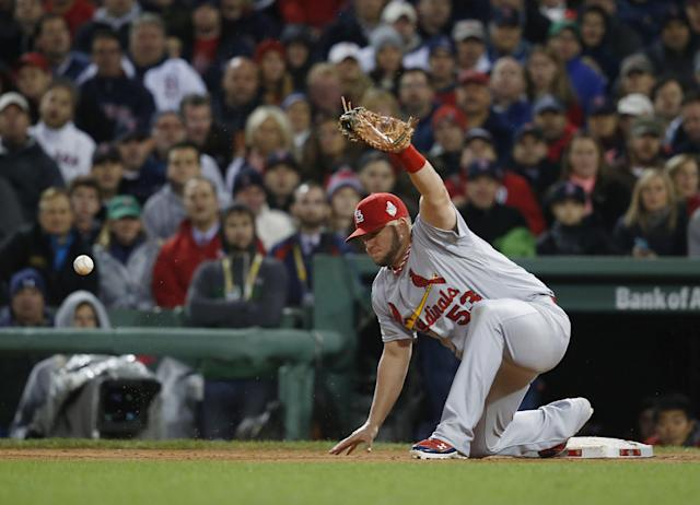 St. Louis Cardinals first baseman Matt Adams attempts to catch ball thrown by David Freese during the seventh inning of Game 1 of baseball's World Series against the Boston Red Sox Wednesday, Oct. 23, 2013, in Boston. (AP Photo/Elise Amendola)