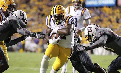 LSU running back Kenny Hilliard (27) carries during the first half of an NCAA college football game against South Carolina in Baton Rouge, La., Saturday, Oct. 13, 2012. (AP Photo/Gerald Herbert)