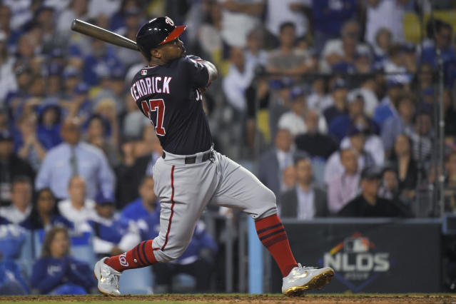 Washington Nationals' Howie Kendrick watches his grand slam against the Los Angeles Dodgers during the 10th inning in Game 5 of a baseball National League Division Series on Wednesday, Oct. 9, 2019, in Los Angeles. (AP Photo/Mark J. Terrill)