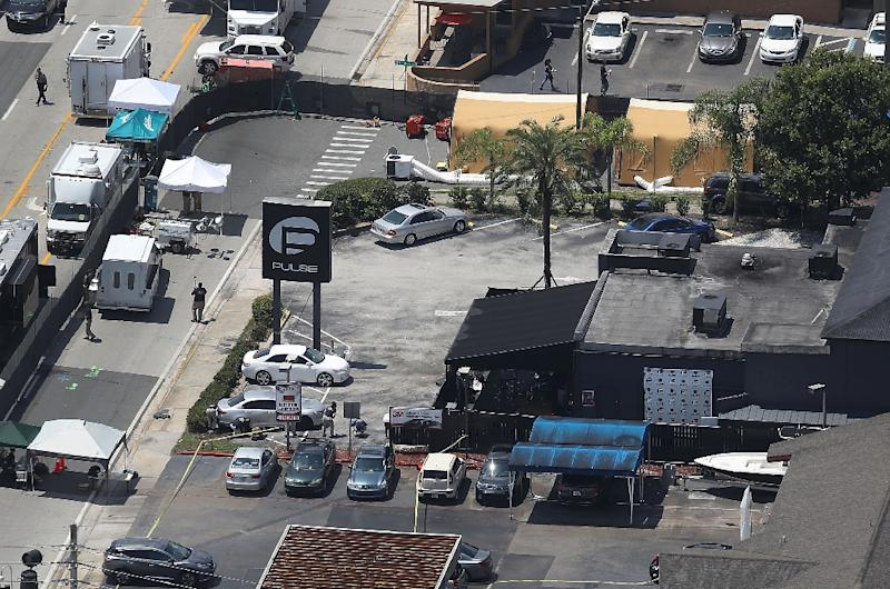 Law enforcement officials continue the investigation at the Pulse nightclub on June 15, 2016 in Orlando, Florida