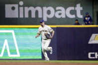 Milwaukee Brewers' John Axford enters a baseball game against the Pittsburgh Pirates during the ninth inning Monday, Aug. 2, 2021, in Milwaukee. (AP Photo/Jeffrey Phelps)