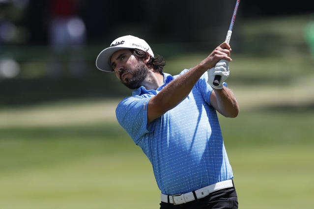 Mark Hubbard hits from the first fairway during the third round of the Rocket Mortgage Classic golf tournament, Saturday, July 4, 2020, at the Detroit Golf Club in Detroit. (AP Photo/Carlos Osorio)