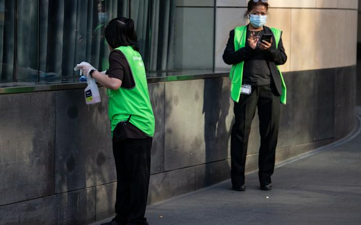 Staff sanitize the premises outside the Star Casino in Sydney. According to local media reports, a man who visited the casino has tested positive to COVID-19 while 13 people are now linked to a cluster at a Sydney pub - JAMES GOURLEY/EPA-EFE/Shutterstock/Shutterstock