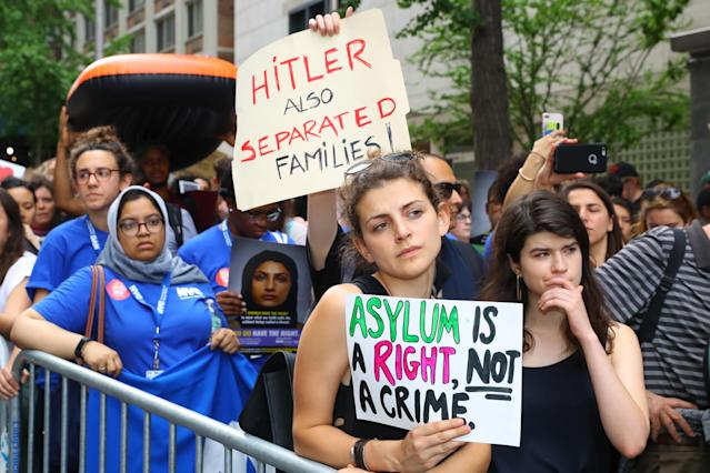 <p>A demonstrator holds up a sign with the names of people who died or were denied asylum in the U.S. in New York City on June 20, 2018. (Photo: Gordon Donovan/Yahoo News) </p>
