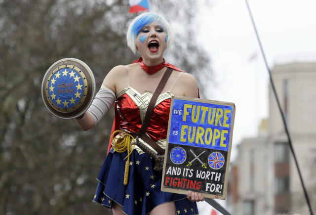 A demonstrator holds a holds a poster during a Peoples Vote anti-Brexit march in London, Saturday, March 23, 2019. The march, organized by the People's Vote campaign is calling for a final vote on any proposed Brexit deal. This week the EU has granted Britain's Prime Minister Theresa May a delay to the Brexit process. (AP Photo/Kirsty Wigglesworth)