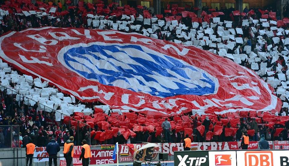 The Volkswagen group and its subsidiaries are sponsors of 17 professional clubs on the top and second leagues, with its premium carbrand Audi, for instance, a shareholder of both Bayern Munich and FC Ingolstadt (AFP Photo/John MacDougall)