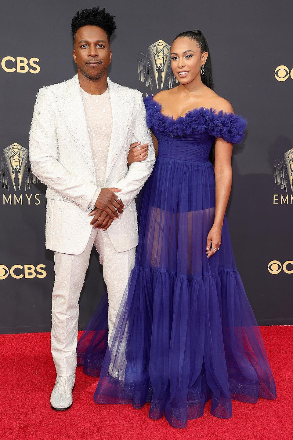 """<p>The <em>Hamilton </em>star and his wife looked ready to be in """"The Room Where It Happens"""" as they hit the red carpet. Odom wore a white, sequined suit, while Robinson opted for a semi-sheer, off-the-shoulder blue gown. </p>"""
