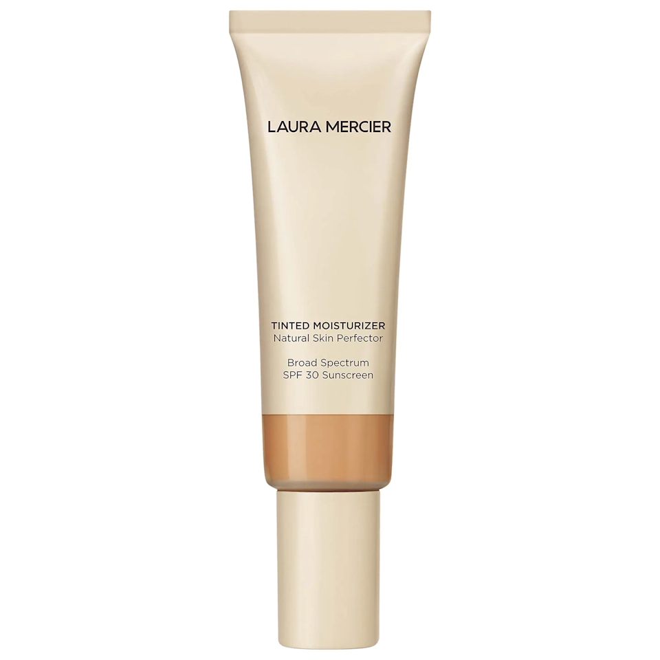 """When I'm in a rush, this tinted moisturizer is the only product I'll put on. It gives me the confidence of a full face of makeup while also making me look as though I just came back from a beach vacation. It also blends really nicely with all of the other makeup products I use routinely, like <a href=""""https://www.sephora.com/product/flex-concealer-P419515"""" rel=""""nofollow"""">Milk Makeup Flex Concealer</a> and <a href=""""https://www.glossier.com/products/cloud-paint"""" rel=""""nofollow"""">Glossier Cloud Paint</a>. Plus it lasts forever! The tube itself is not that large, but I've used it every day for four months now and I haven't run out. <em>— Tara Gonzalez, commerce editor</em> $47, Laura Mercier Tinted Moisturizer. <a href=""""https://www.sephora.com/product/tinted-moisturizer-broad-spectrum-P109936?skuId=2250611"""">Get it now!</a>"""
