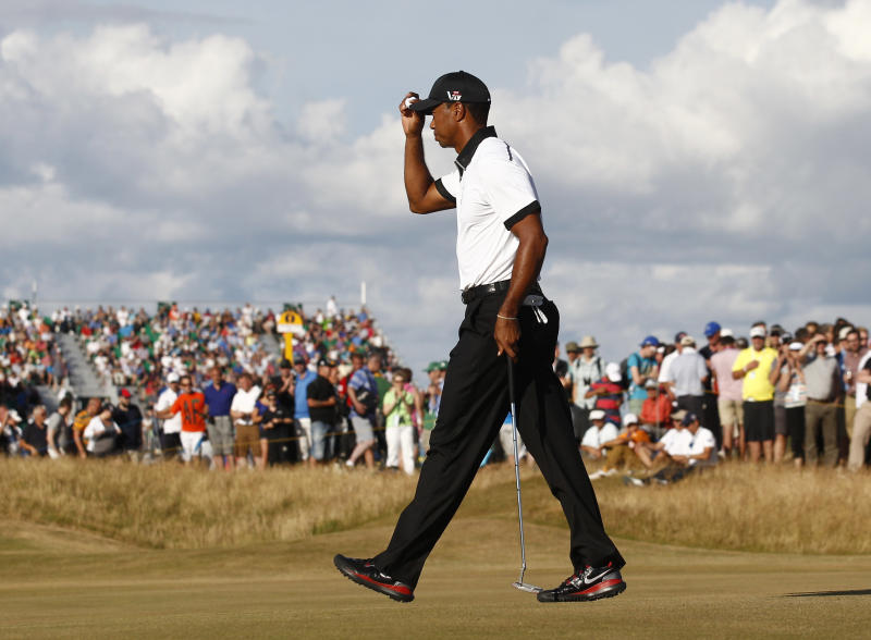 Tiger Woods of the United States walks off after playing the 14th green during the first round of the British Open Golf Championship at Muirfield, Scotland, Thursday July 18, 2013. (AP Photo/Jon Super)