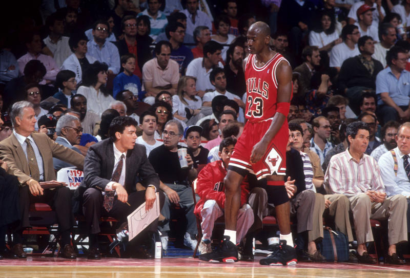 PHILADELPHIA, PA - MAY, 1991: Michael Jordan #23 of the Chicago Bulls walks to the bench duing a game in the 1991 Eastern Conference Semifinals against the Philadelphia 76ers in May, 1991 at the Spectrum in Philadelphia, Pennsylvania. (Photo by B Miller/Bruce Bennett Studios via Getty Images Studios/Getty Images)