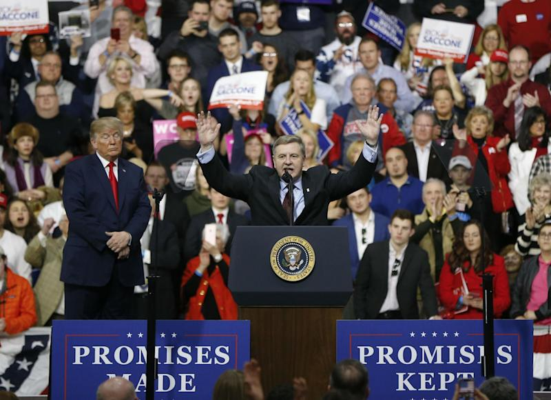 Republican Rick Saccone acknowledges the crowd during a campaign rally with President Donald Trump: AP
