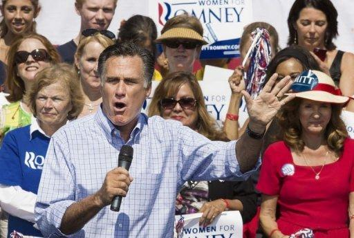 """US Republican Presidential candidate Mitt Romney delivers remarks at a campaign rally in Fairfax, Virginia. Romney renewed his vow Thursday to brand China a currency manipulator as he accused incumbent Barack Obama of failing to confront """"cheating"""" by Beijing"""